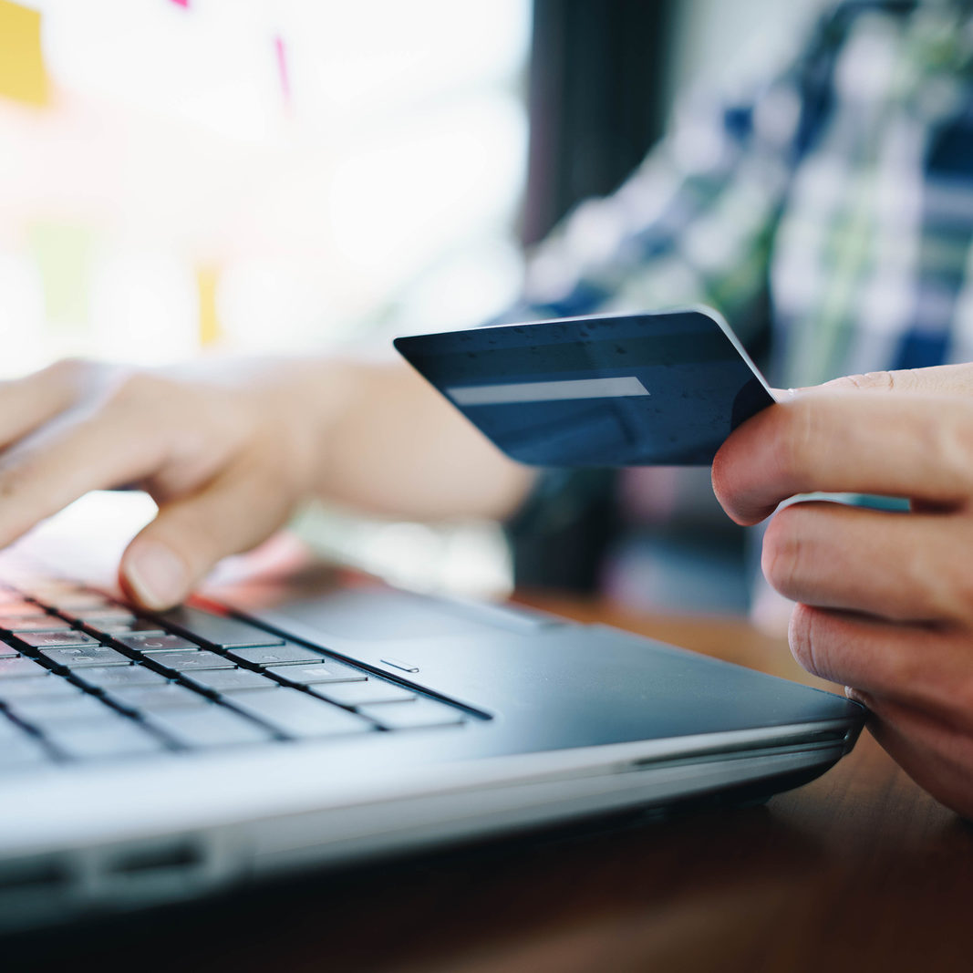 Man with laptop and credit card for shopping online. Pays for purchase.online shopping, online payment,buy and sell products & services